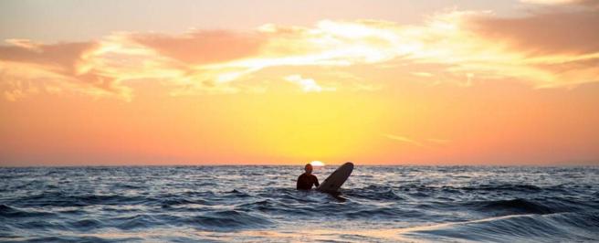Sunset surf. Photo by  Alex Nye .