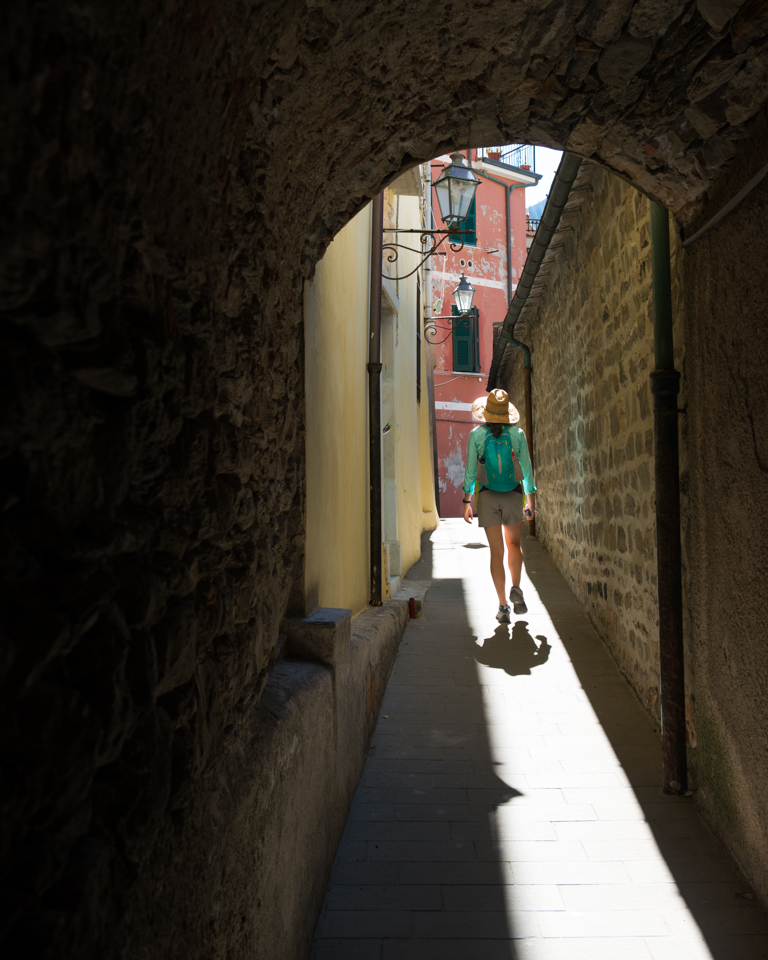 Chelsea wandering the narrow streets of Manarola.
