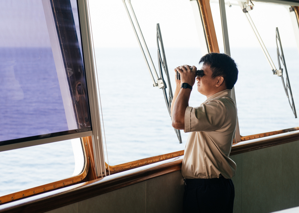 The Able Seaman keeps a look out on the bridge of the MV World Odyssey.