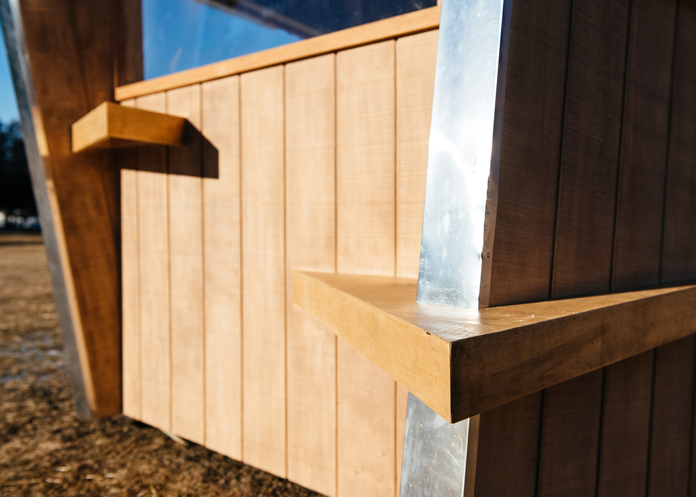 Benches mounted on the inside and protrude to the outside.
