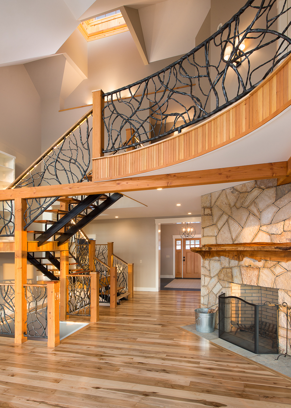 Stone fireplace and the staircase leading to the upper loft.