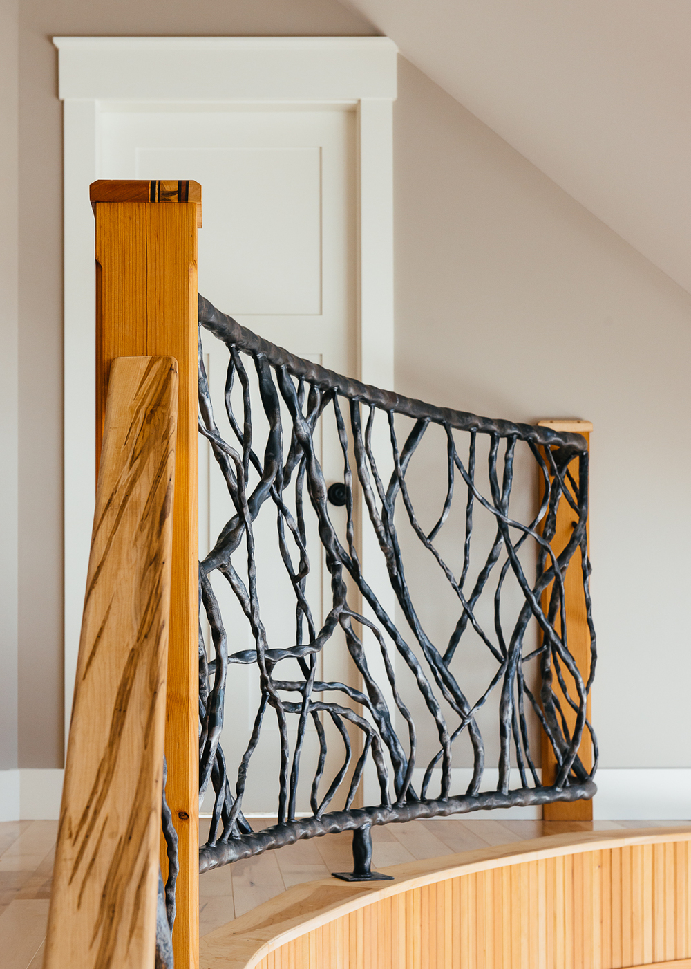 Metal railings shaped like tree branches help bring the feeling of being outside in.