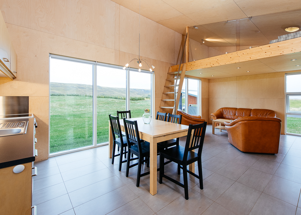 Kitchen in the Einishus Cottage. The large glass windows gave the feeling of being outdoors.