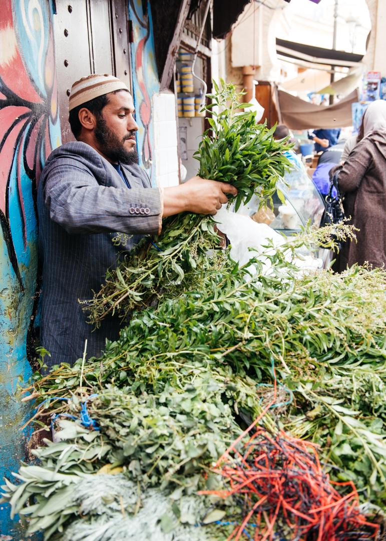 Vendor selling fresh herbs.
