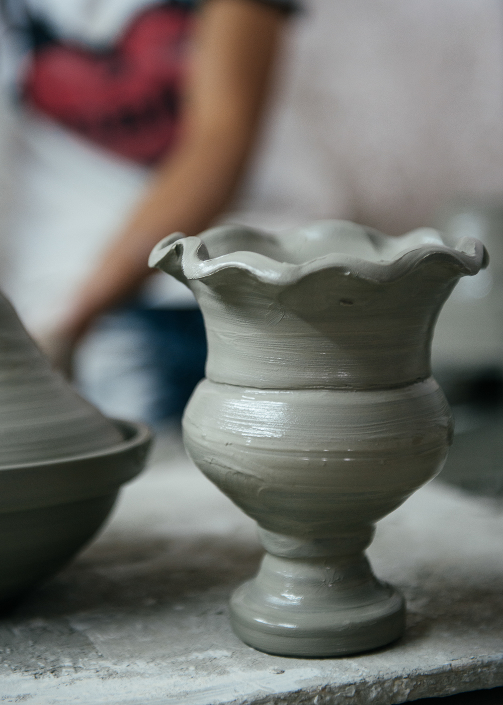 A finished clay chalice sits out to dry.