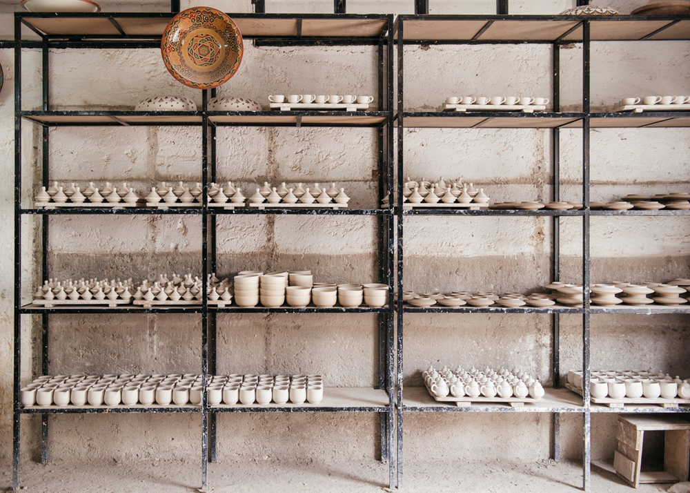 Pottery set out to dry before being painted.