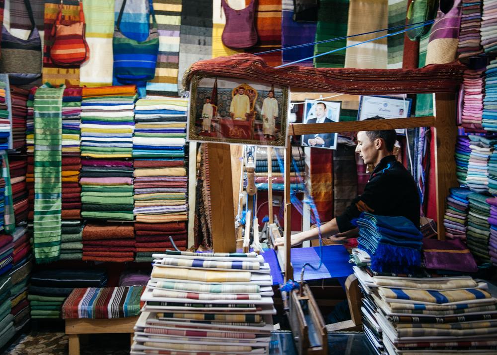 An artisan working on a garment.
