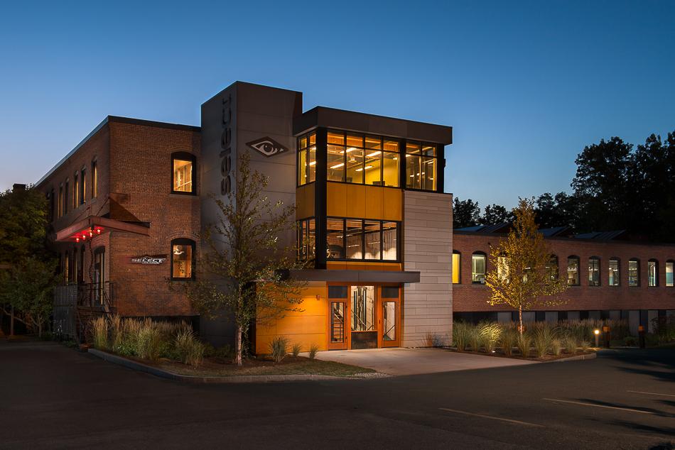 Select Design building at dusk