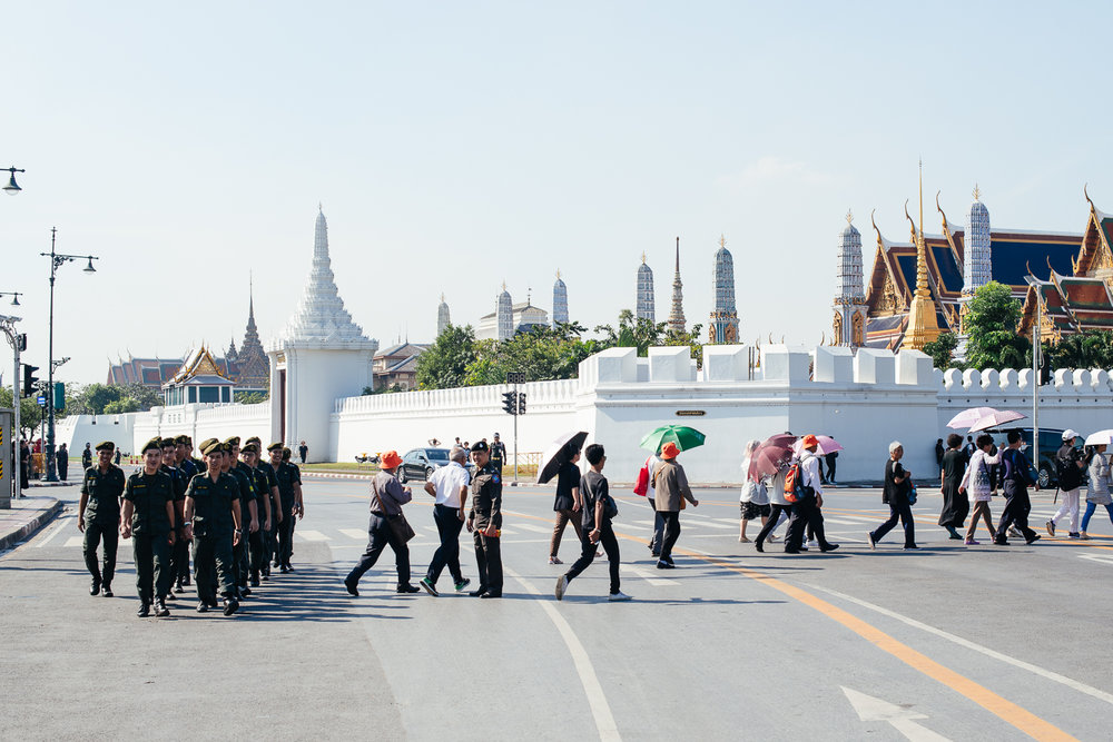 The army of Thailand and people heading to the shrine of the late King Bhumibol Adulyadej.
