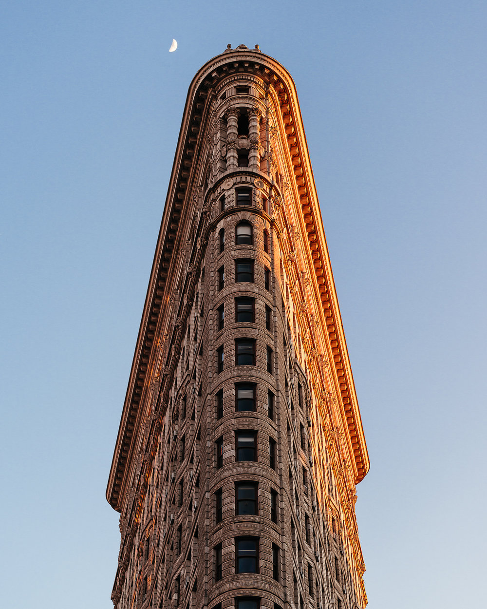 The Flatiron Building opened in 1902 as a groundbreaking skyscraper of its time. Its name derives from its likeness of a cast-iron clothes iron.