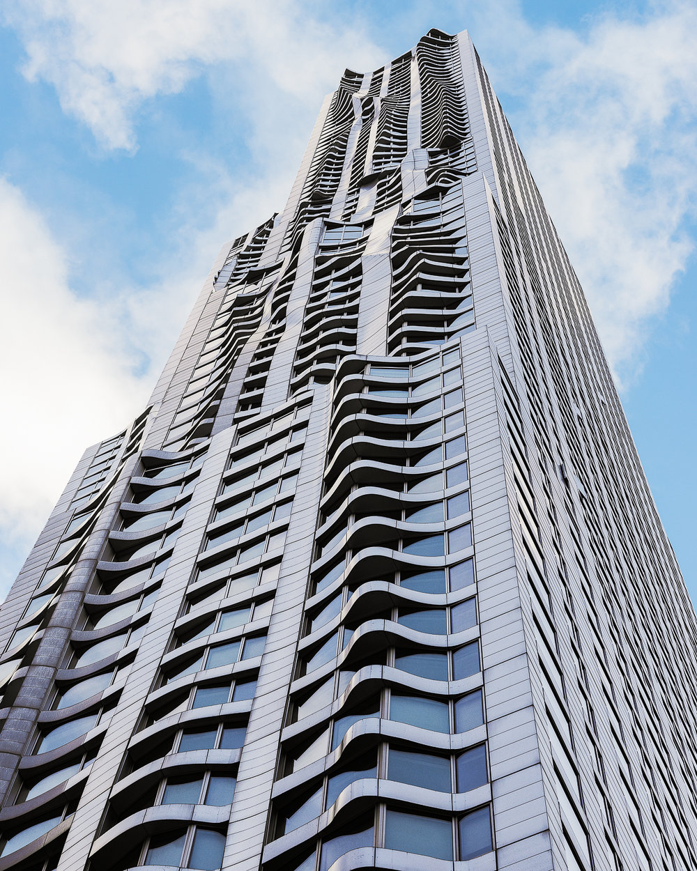 Beekman Tower - architect - Frank Gehry. Opened in 2011 as one of the tallest residential building in the world. The towers deconstructivism architecture style and stainless-steel facade undulates as if it is being blow by the wind.