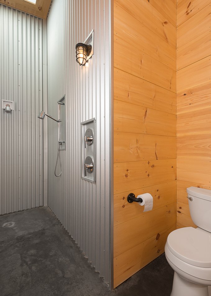 Master bathroom with corrugated metal walls.
