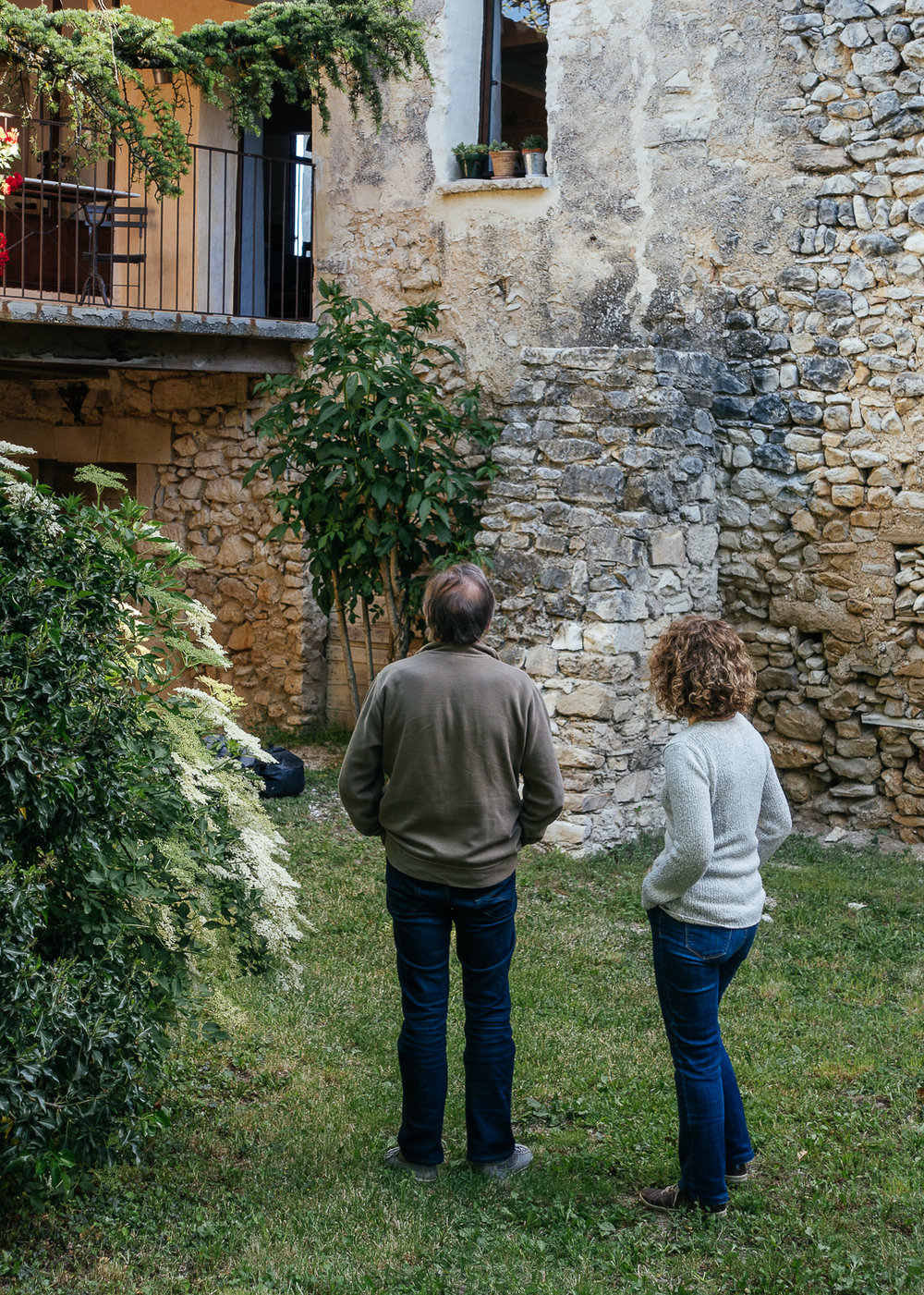 AirBnB hosts, Fabienne and Jean-Daniel admiring their work.