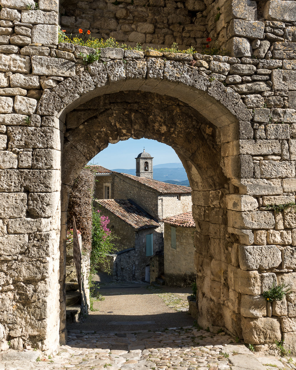 Stone archway in Lacoste, France.