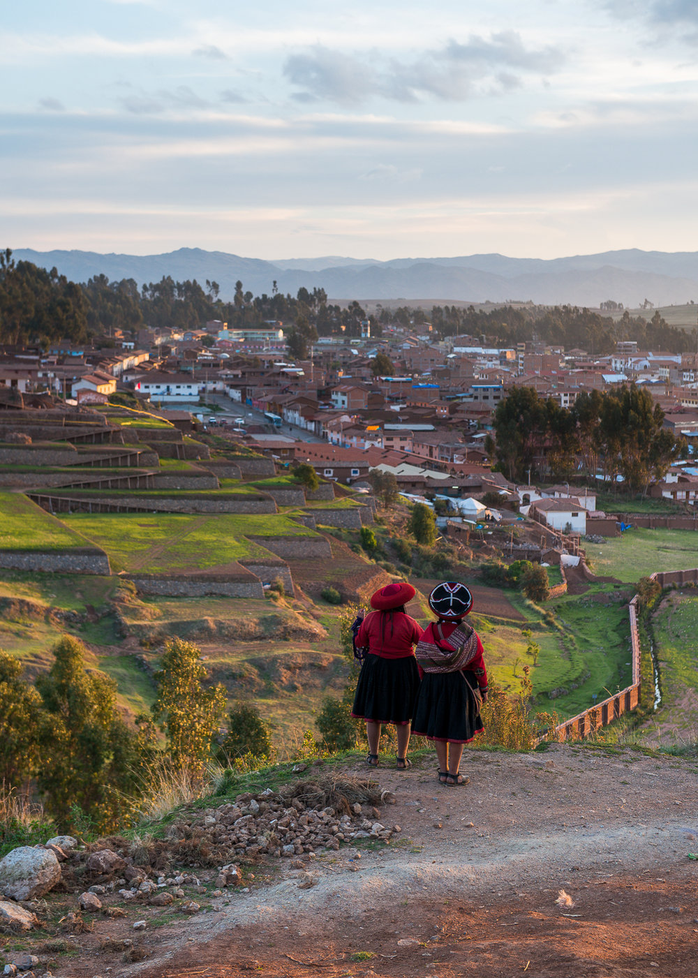 Traditional Inca women looking over the town of Chinchero.