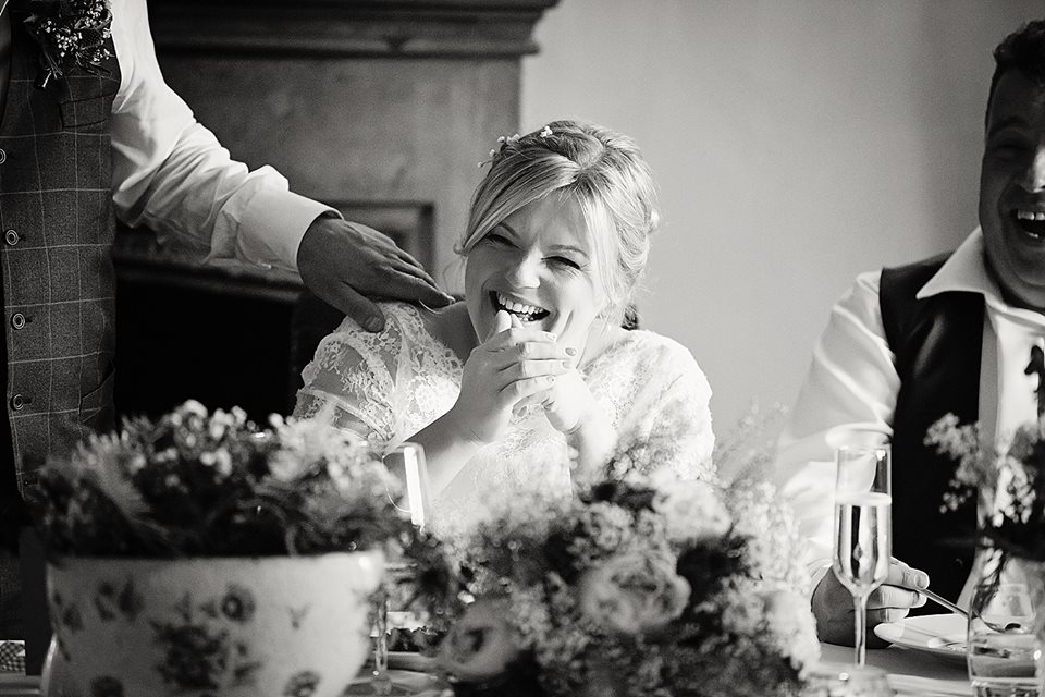 bride laughing wedding breakfast.jpg
