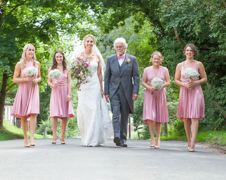 bridal party walking to the church.jpg