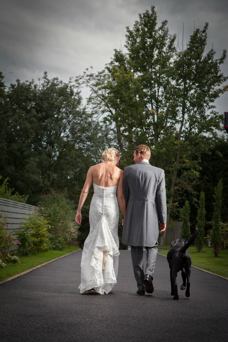 bride and groom walking with dog.jpg