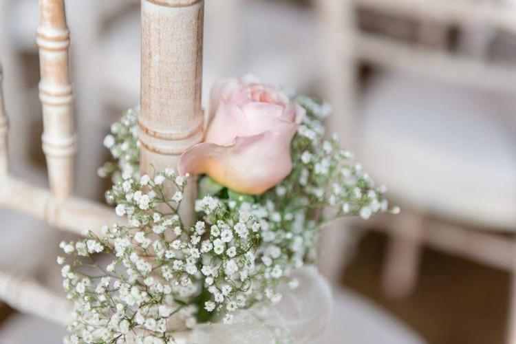 flowers on chair wedding.jpg