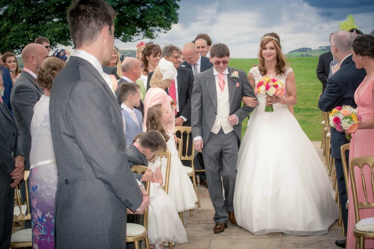 Joanna Rowsell and Daniel Shand Heaton House Farm Wedding walking down the aisle.jpg