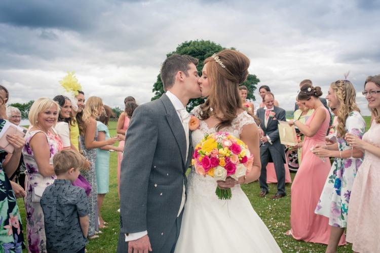 Joanna Rowsell and Daniel Shand Heaton House Farm Wedding kiss.jpg