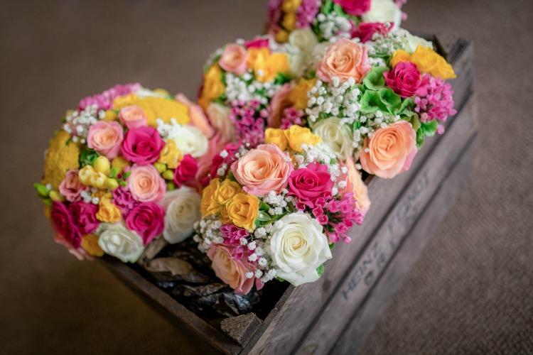 Joanna Rowsell and Daniel Shand Heaton House Farm Wedding bright flowers.jpg