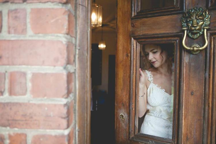 Claire-Pettibone-Wedding-Dress-Bride-Looking-Through-Door.jpg