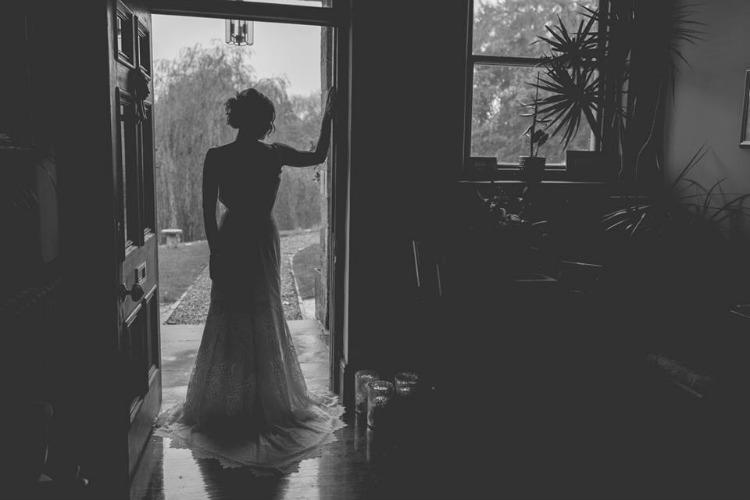 Claire-Pettibone-Wedding-Dress-Bride-In-Doorway.jpg