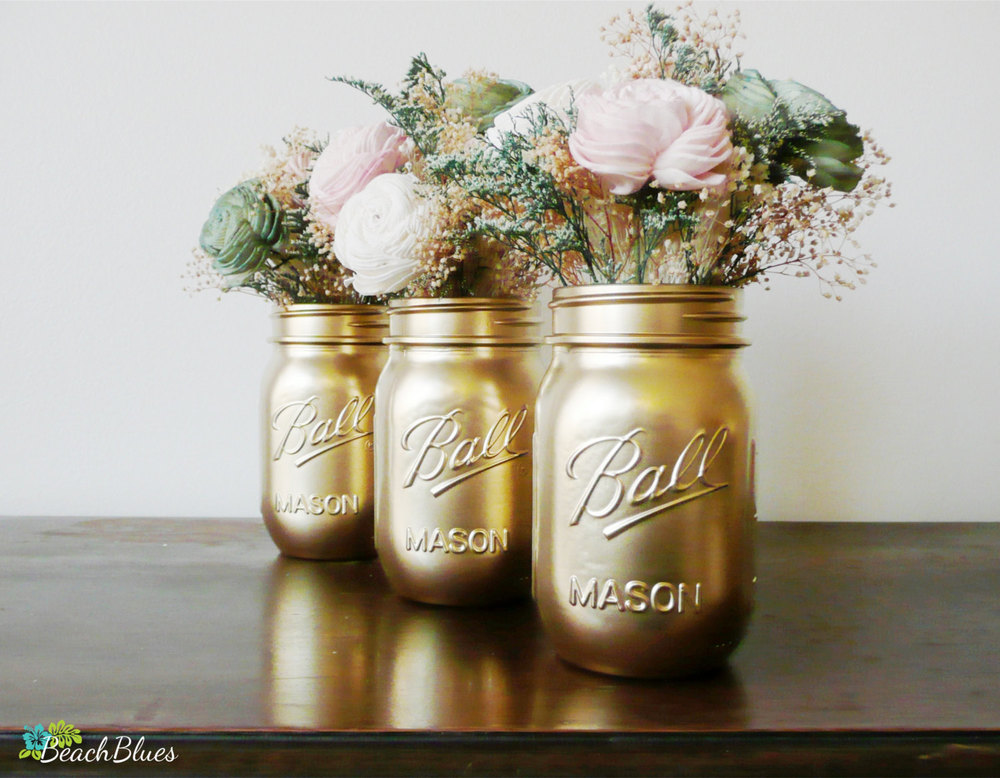 https://www.theknot.com/real-weddings/diy-gold-mason-jar-and-vintage-book-centerpieces-photo?context=diy-wedding-decorations-accents-photos&page=1