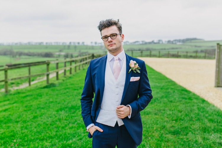 groom-in-blue-suit-with-pink.jpg
