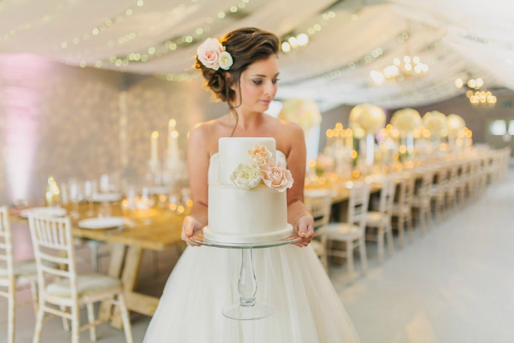 bride-with-floral-wedding-cake.jpg