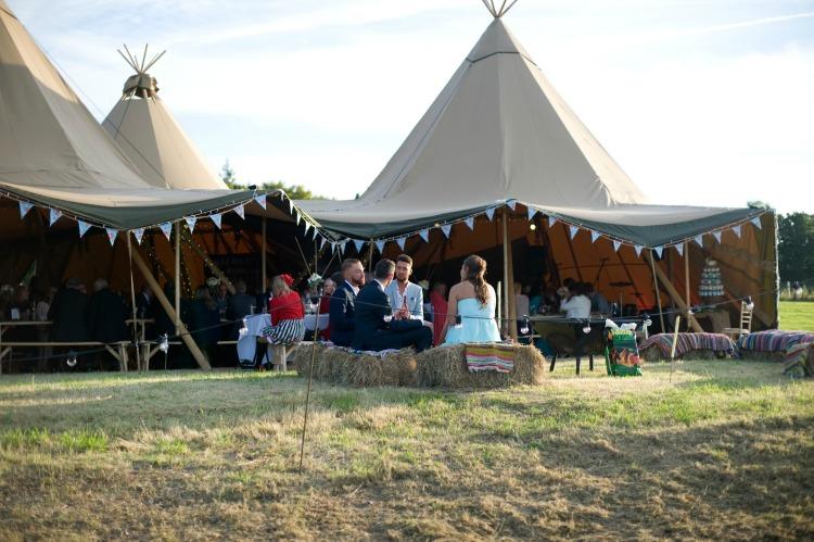 Tipi guests on hay bails.jpg