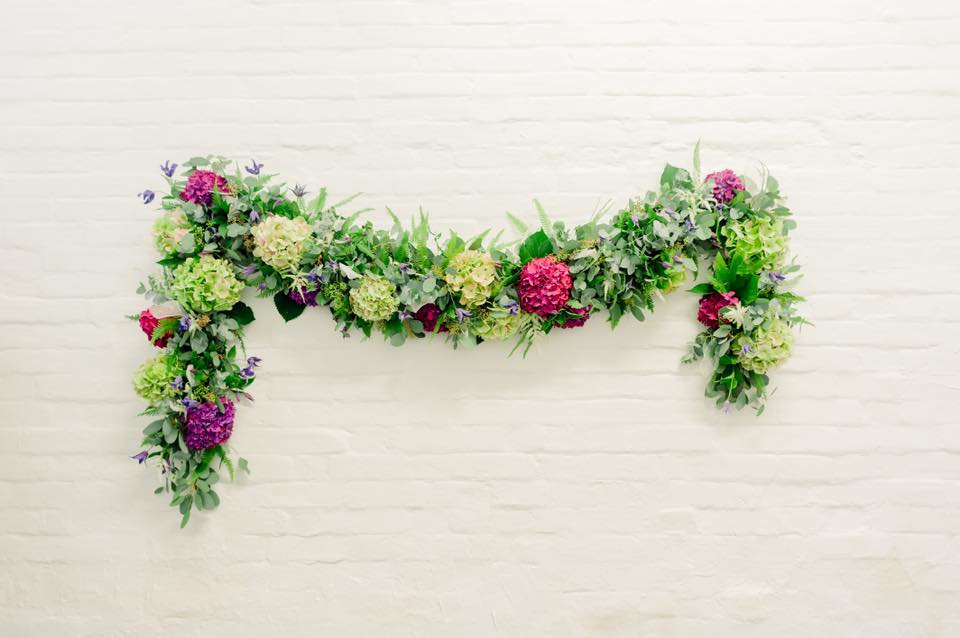Colourful wedding floral arch