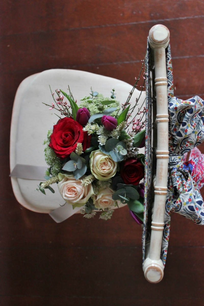 vintage wedding chair sashes with flowers.jpg