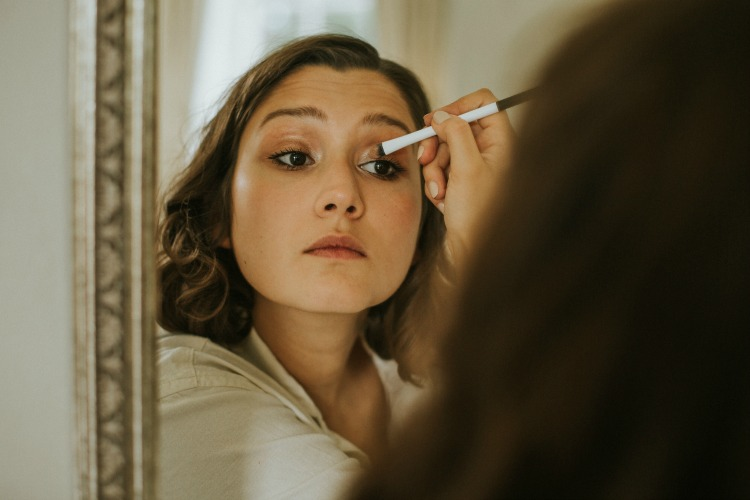 Bride doing her makeup.jpg