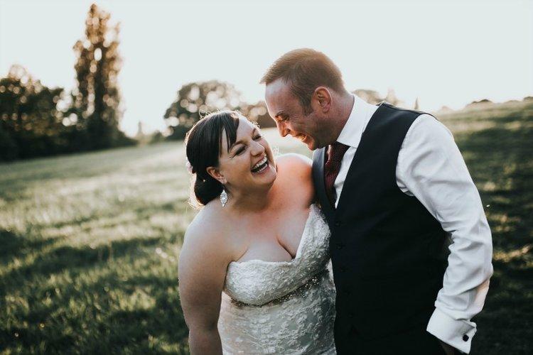Erin + Stuart - wedding couple laughing.jpg