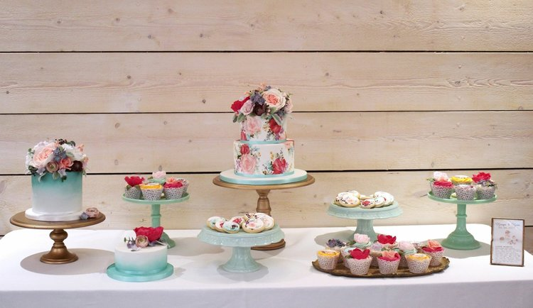 The Sugared Rose blue peach and red floral cake table.JPG