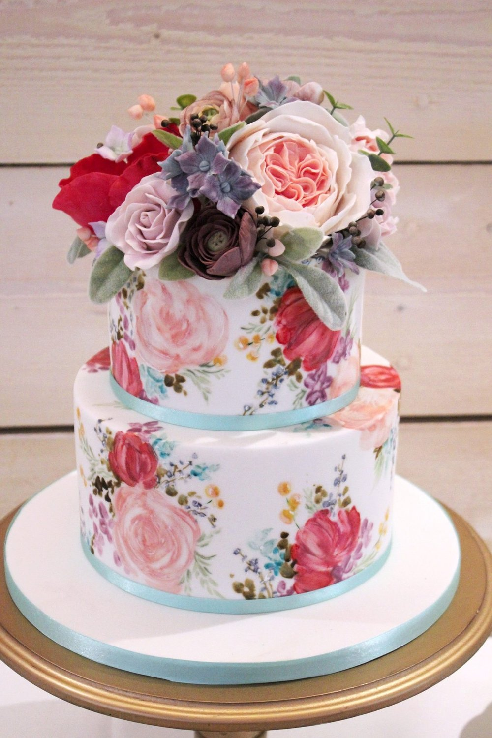 The Sugared Rose blue peach and red floral cake flowers.JPG