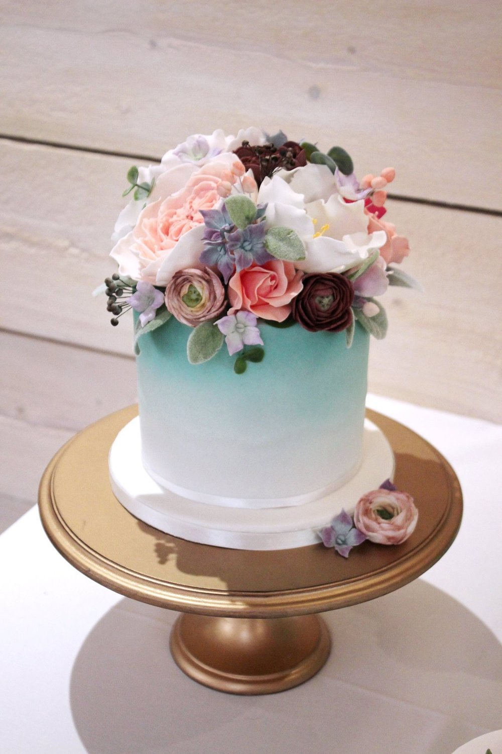 The Sugared Rose blue peach and red floral ombre cake.JPG
