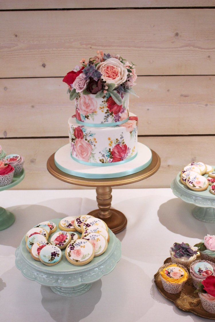 The Sugared Rose blue peach and red floral small cake.JPG