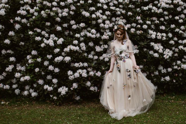 Agnes Black Liverpool wedding photographer white flower backdrop.jpg