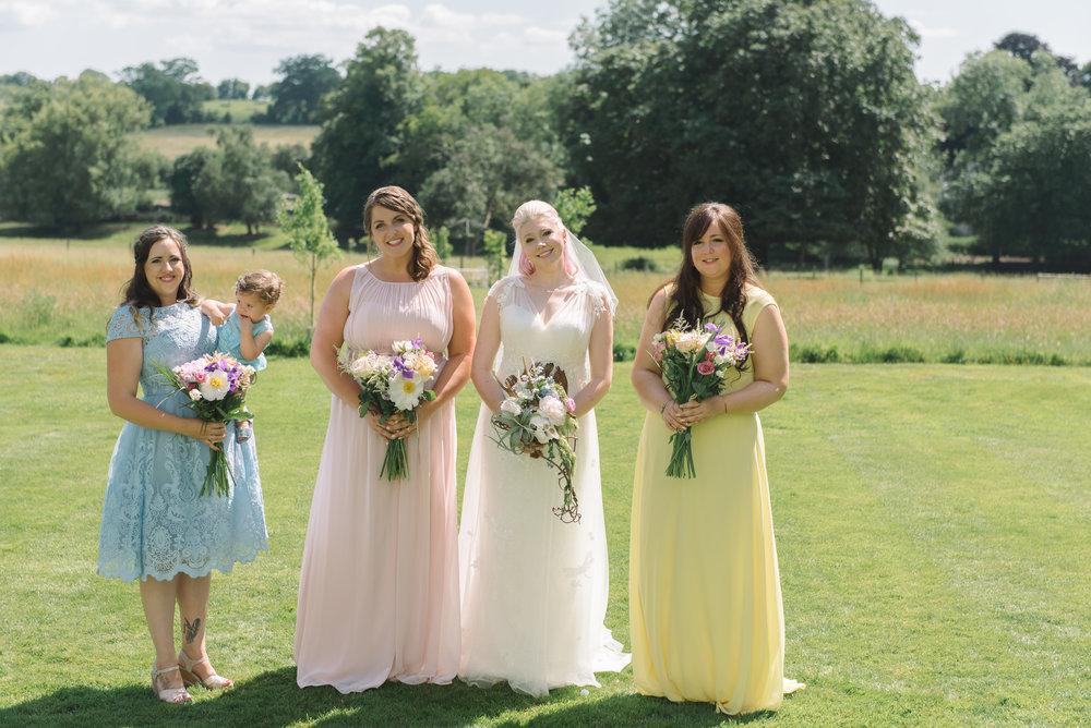 mismatched pastel bridesmaid dresses.JPG