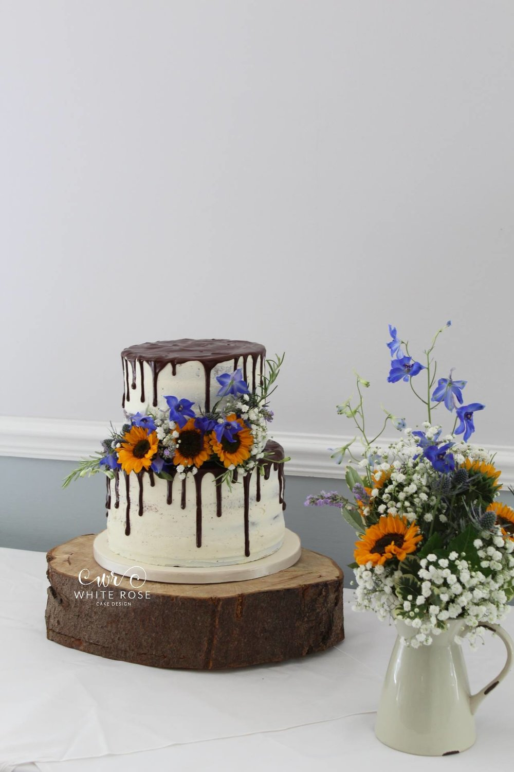 Chocolate Drip Wedding Cake with Bright Blooms by  White Rose Cake Design