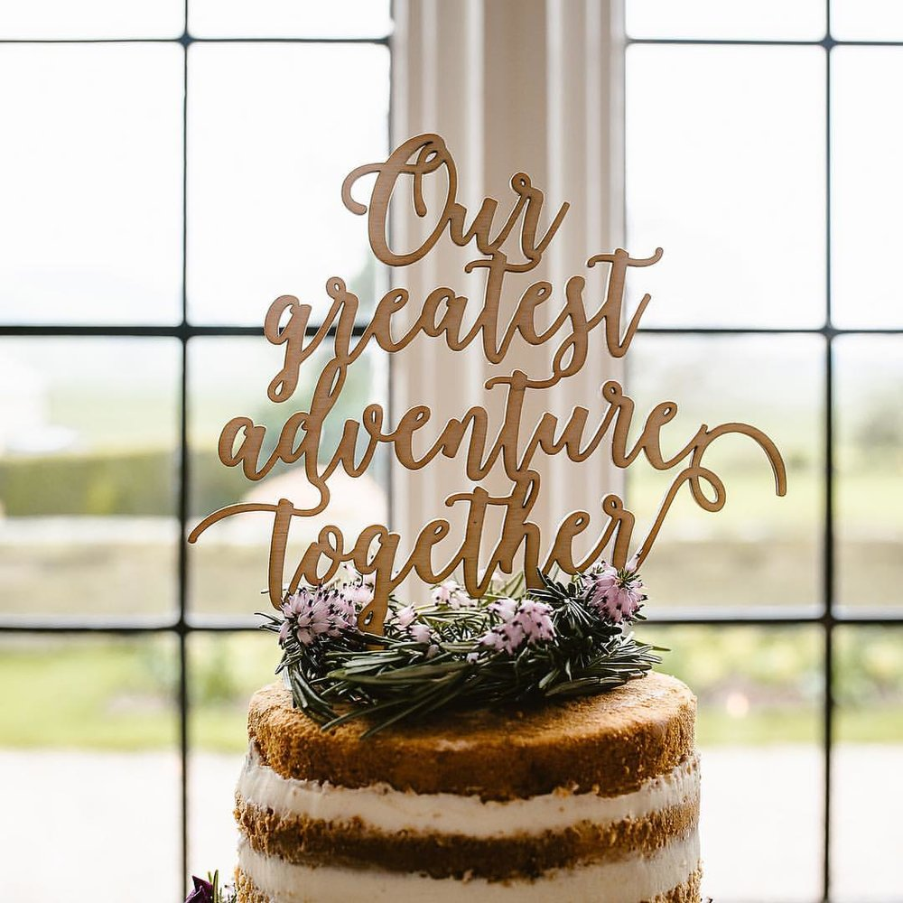 Cake topper by  Suzanne Oddy Design Limited  (photography by  GBP Weddings