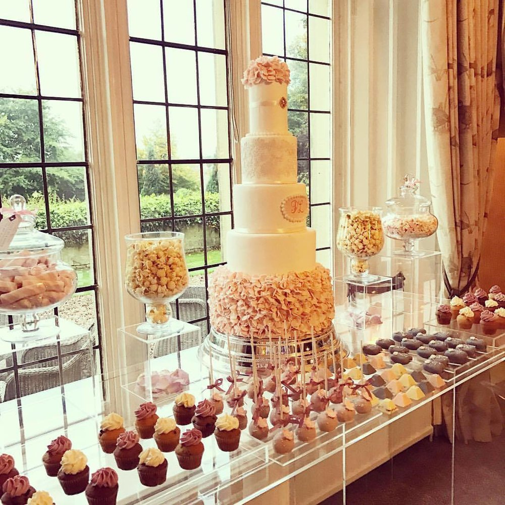 Gorgeous cake table by  The Whimsical Cake Company