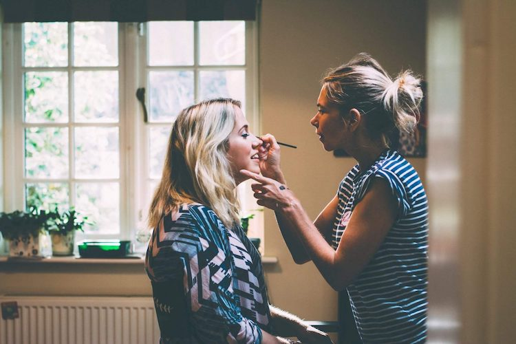 Amy George working her make up magic