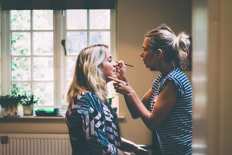Amy George working her make up magic