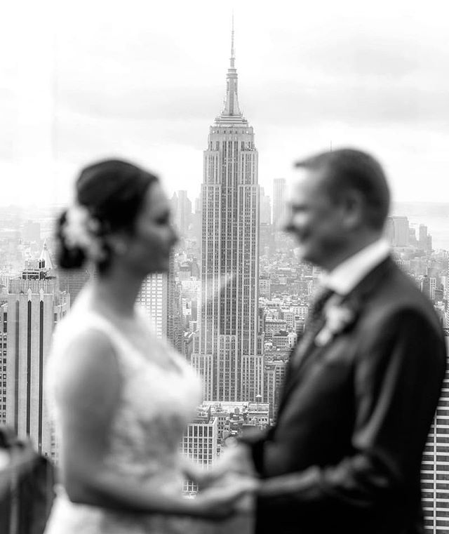 The iconic Empire State Building creates a stunning backdrop for ceremonies at Top of the Rock! #empirestatebuilding #topoftherock #weddingphotographer #wedding #weddingplannernyc #elopement #newyorkelopement #newyork #weddinginspo #elopementplanner #newyorkdreamweddings #harleyhall #elopenyc #weddingphotography #blackandwhite #newyork #love #elope #creative #weddings #nywedding #harleyhallphotography #tourists #love #instawedding #weddingportrait