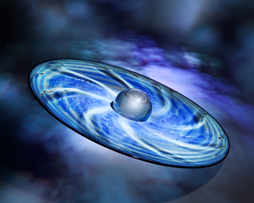 Saturn ringed with shades of blue, emitting bright rays of white light