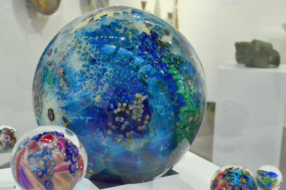 Large and small Planet's displayed at the Fuller Craft Museum's Exhibit: (413): Pioneering Western Massachusetts